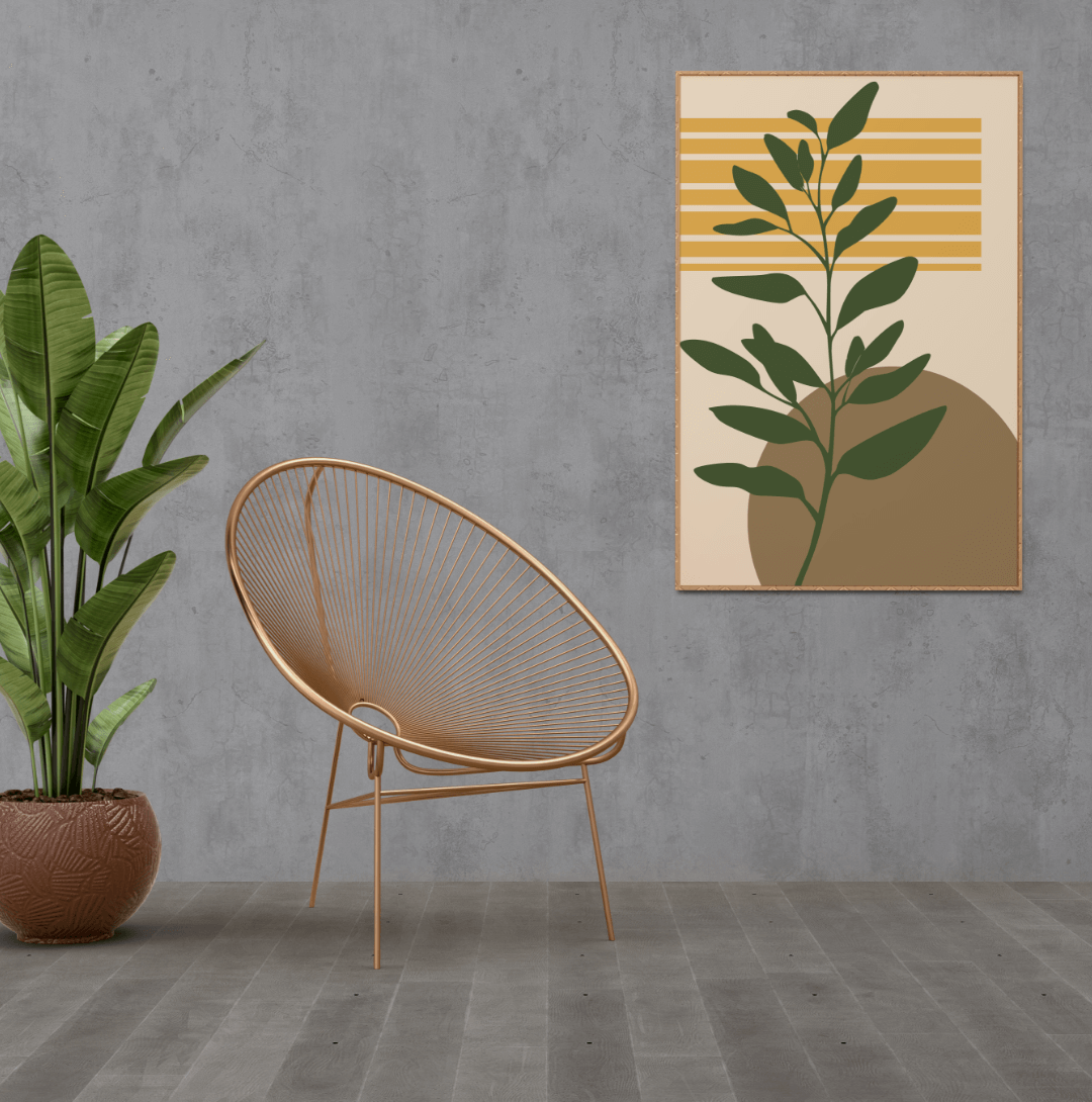 Boho style green leaves with a brown sun and yellow lines on a light pink background in a brown frame hanging from a dark grey wall in a boho style room with a plant and a brown chair, poster ideas for your interior design