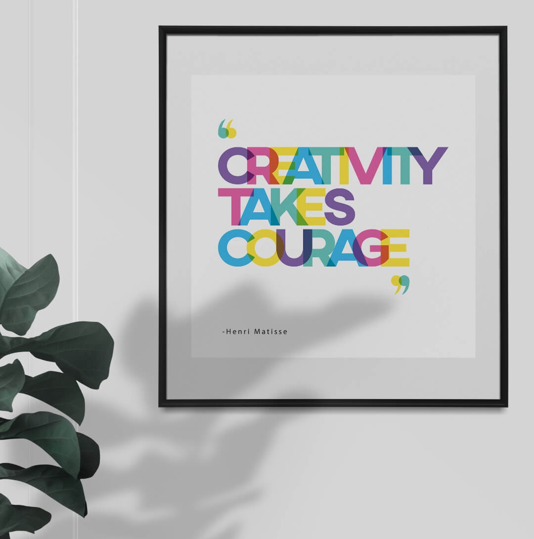 CREATIVITY TAKES COURAGE Typography Printable Poster with colorful fonts and left align text on a white background in a dark frame hanging from a white wall near a plant, poster ideas for your interior design
