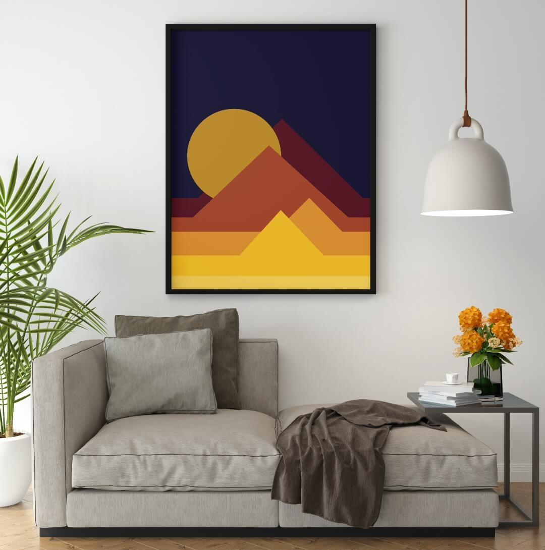 Pyramids Abstract Printable Poster in a dark frame hanging from a white wall in a living room with a sofa, poster ideas for your interior design